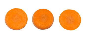 Top view of fresh three carrot slice isolated on white background, File contains a clipping path. Close up top view of fresh three carrot slice isolated on white Stock Photo