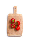 Top view of fresh tomatoes on chopping board Stock Photos
