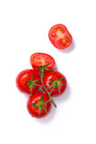 Top view of fresh tomatoes, whole and half cut Royalty Free Stock Photography