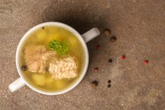 Top view of fresh transparent fish soup with sturgeon, potatoes royalty free stock images