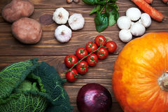 Top view at fresh vegetables on a wooden table. Fresh vegetables lying on a rustic wooden table. Top view Stock Photography