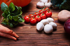 Top view at fresh vegetables on a wooden table Royalty Free Stock Images