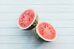 Top view of fresh watermelon halves on white. Wooden surface royalty free stock photos