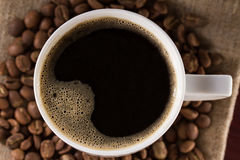 Top view of a freshly brewed Cup black French coffee fabric from jute Royalty Free Stock Image