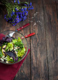 Top view of freshly harvested lettuce, lemon, blue cheese, pearand flowers on an old wood table Stock Photography
