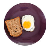 Top view of fried egg and toasted rye bread Royalty Free Stock Photo