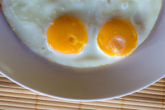Top view fried eggs on dish Stock Images