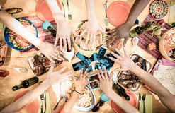 Top view of friend hands on food with mobile smart phones. Top view of friend hands with mobile smart phones at barbecue garden party - Multiracial people group royalty free stock photos