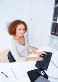 Top view of a friendly woman working at office Royalty Free Stock Images
