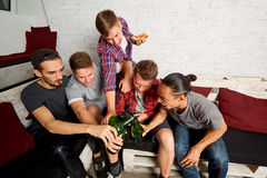Top view friends with a bottle of beer in his hand ,clinked bott. Les cin cin screaming fun. The concept of male friendship Royalty Free Stock Photography