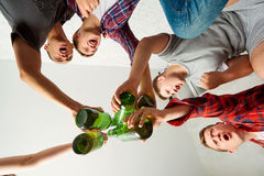Top view friends with a bottle of beer in his hand ,clinked bott. Les cin cin screaming fun. The concept of male friendship Stock Photo