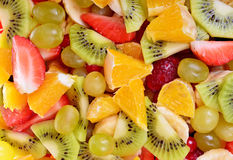 Top view of a fruit salad with strawberries, oranges, kiwi, blueberries Royalty Free Stock Images