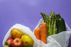 Top view of Fruit and vegetables on reusable bags with copy space royalty free stock photo