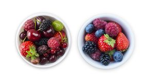 Top view. Fruits and berries in bowl isolated on white background. Ripe raspberries, cherries, strawberries, blackberries and blue. Berries. Background of mix stock images
