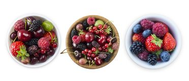 Top view. Fruits and berries in bowl isolated on white background. Ripe raspberries, cherries, strawberries, blackberries and blue. Berries. Background of mix stock photography