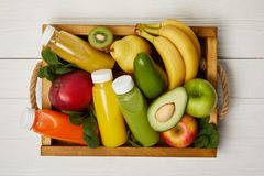 Top view of fruits and detox smoothies in wooden box Stock Photo