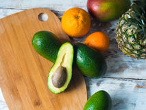 Top view of fruits on the table. Avocado, mango, pinnaple. Healthy food concept Stock Photos