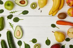 Top view of fruits and vegetables on wooden background with copy space Stock Image