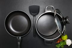 Top View Frying Pan And Pot On Black Table. Stock Photos