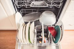 Top view of a full dishwashing machine with open door Royalty Free Stock Images