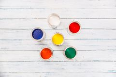 Top of view full of multicolored paint cans on table royalty free stock photo