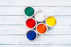 Top of view full of multicolored paint cans on table stock photo
