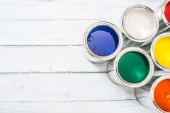 Top of view full of multicolored paint cans on table.  royalty free stock photos
