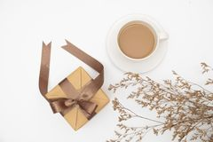 Top view Gift box and a cup of coffee on white background royalty free stock photos
