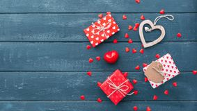 Top view of gift box with and red hearts decorations on Valentines day. Over wooden background Royalty Free Stock Photos