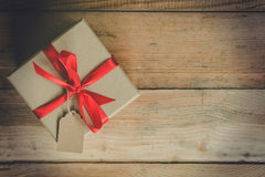 Top view gift box on wood table background with space. royalty free stock image