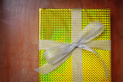 Top view of gift box wrap and ribbon with gold foil shiny wrappi Stock Images