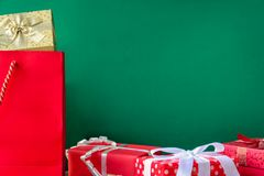 Top view gift boxes in bag and shopping mall. And green background with the holiday season Stock Photography