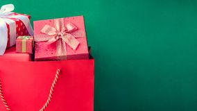 Top view gift boxes in bag and shopping mall. And green background with the holiday season Royalty Free Stock Images