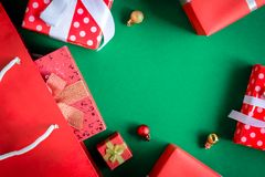 Top view gift boxes in bag and shopping mall on the green table. With the holiday season Stock Images