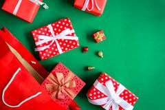Top view gift boxes in bag and shopping mall on the green table. With the holiday season Royalty Free Stock Photos