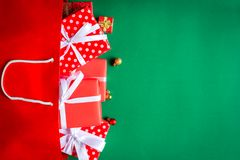 Top view gift boxes in bag and shopping mall on the green table. With the holiday season Stock Image