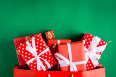 Top view gift boxes in bag and shopping mall on the green table. With the holiday season Royalty Free Stock Image