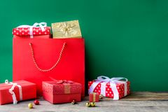 Top view gift boxes in bag and shopping mall. And green background with the holiday season Stock Image