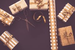 Top view of gift boxes in golden designs. Flat lay, copy space. A concept of Christmas, New Year, birthday celebration. Event royalty free stock image