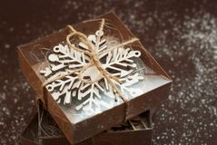 Top view of Gift Christmas Boxes. Presents in craft paper with laser cut snowflakes gift. Christmas, holidays concept royalty free stock images