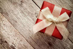 Top view of giftbox with golden bow. Stock Photography
