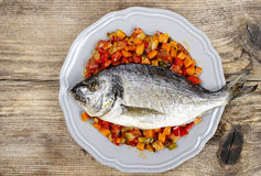 Top view of gilt-head bream fish. On wooden background. Symbol of healthy living Royalty Free Stock Image