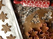 Gingerbread cookie cutouts. Top view of gingerbread cookie preparations royalty free stock image