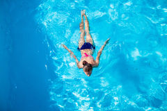Top view of a girl diving in the swimming pool Royalty Free Stock Images