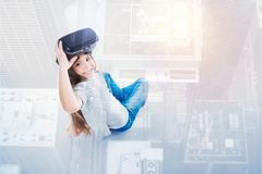 Top view of girl removing her VR headset Royalty Free Stock Images