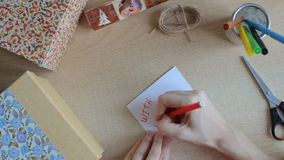 Top view of girl`s hands write greeting card stock video