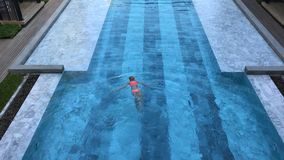 Top view of a girl in the swimming pool stock video