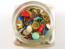 Top view of glas with pins. Top view of coloured pins Stock Photos
