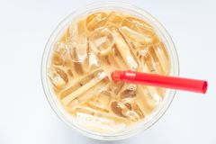 Top view of glass of iced coffee on white background stock photography