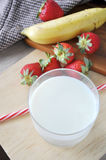 Top view of Glass of Milk with Fresh Fruits Stock Images